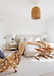 how to style the foot of your bed according to interior designers