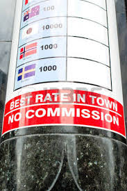 a currency rates poster outside an exchange bureau in stock