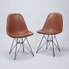 pair of eiffel side chairs by charles and ray eames for herman
