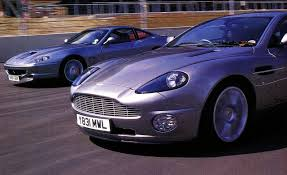 purple aston martin aston martin v 12 vanquish vs ferrari 550 maranello u2013 comparison