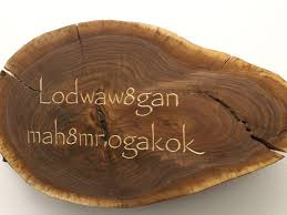 carved wood plank local writer carves endangered alphabets into wood to illuminate