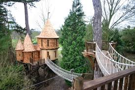 three house this family lives in a treehouse that looks like a castle just
