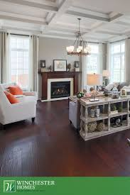 best 25 painted tray ceilings ideas on pinterest master painted tray ceiling in living room dark hardwood flooring and a decorative ceiling in the bradley model give this living room a bold feel