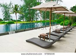swimming pool table set with umbrella beach chairs umbrella side swimming pool stock photo royalty free