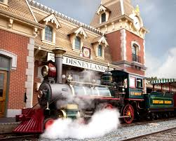 disneyland railroad engineers signal to guests look for