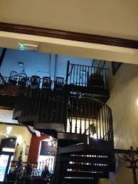bar interior under black wooden spiral stairs design nice and