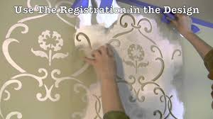 how to stencil a feature wall with cutting edge stencils youtube