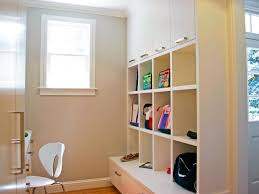 custom wood wall built in mudroom cubby painted with white color