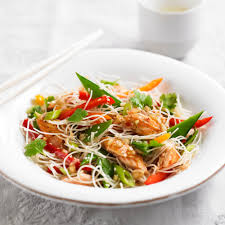 rice noodle salad with smoked salmon woman and home