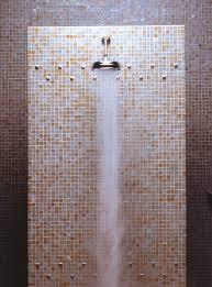 bathroom ocean glass shower with bali pebble tile accents then pebble ocean subway