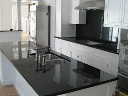 great black granite countertops with white cabinets and black
