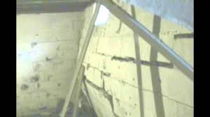 what are the warning signs of foundation wall collapse failure