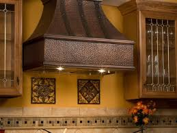 this curved glass stainless steel range hood looks beautiful over