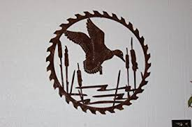 amazon com duck in reeds on sawblade metal wall art country