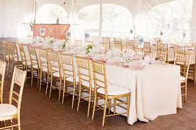 wedding tables and chairs pink rectangular reception tables with gold bamboo chairs