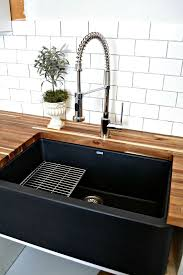 pictures of farmhouse sinks a black farmhouse sink gives our country kitchen a warm feel black