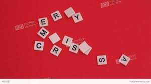 letter tiles moving to spell merry on re stock