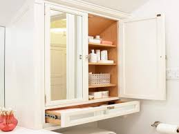 collection in bathroom cabinet over toilet on home decorating