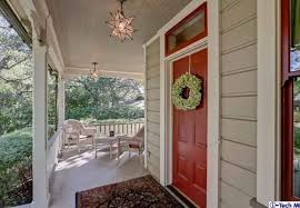 close up of red front door and front porch cottage hooked on houses