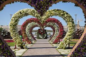 Vertical Flower Bed - rainbow coloured oasis with 45m flowers is in the middle of a