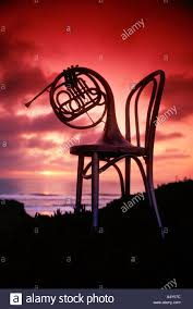 Musical Chairs Horn French Horn On Chair At The Beach At Sunset Stock Photo Royalty