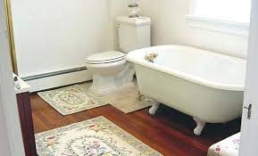 Pictures Of Small Bathrooms With Tub And Shower - this small bathroom space is accented by a corner of wall