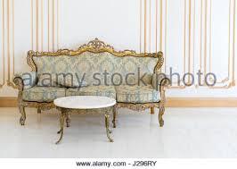 luxury livingroom in light colors with golden furniture details