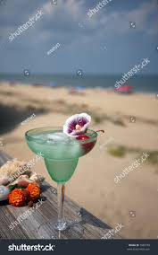 martini beach green margarita cherry flowerocean beach background stock photo