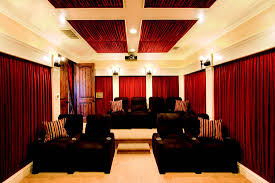 dramatic home theater design with curtains on every wall