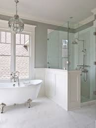 bathroom white clawfoot bathtub bathroom corner shower area two