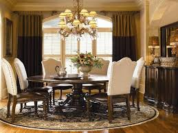 elegant victorian dining room with a dark wood round kitchen table