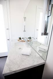 side view of contemporary bathroom vanity wall mirror and lighting