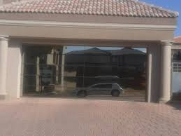 garage glass doors garage doors jhb u0026 garage doors wooden and chromadek installations