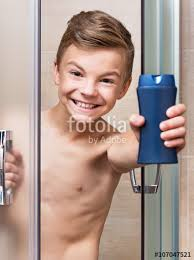 teen boy takes a shower in the bathroom