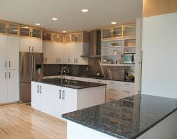 kitchen white granite countertops light wood floor metalic faucet
