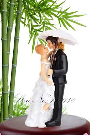 and groom figurines umbrella in the wedding cake toppers
