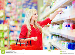 Personal Care Beautiful Woman Choosing Personal Care Product In Supermarket