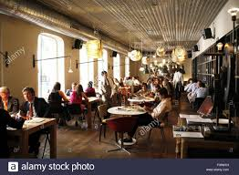 people in dining room of bar tomate madrid spain stock photo