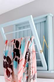 how to build a diy ballard designs laundry drying rack how to build a diy bead board laundry drying rack inspired by ballard designs via jen