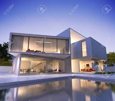 external view of a modern house with pool at dusk stock photo
