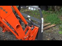 demonstrating a kubota quick attach loader youtube