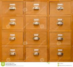 an old rectangular cabinet with twelve drawers stock photo image