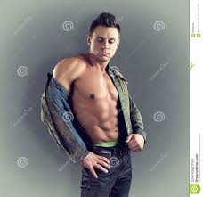 fashion portrait of male model in stylish clothes with muscular
