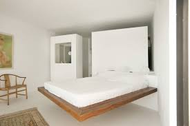 simple large queen floating bed frame on white room divider