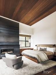 ombre striped fireplace surround in a bedroom bedroom