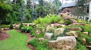 large natural boulders combined with shrubs and perennials yard