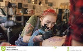 tattoo artist drawing sketch tattoo client body stock footage