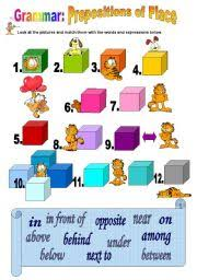 english exercises prepositions toy cupboard