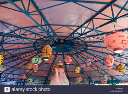 oriental design and lanterns hanging from ceiling of mat tea party