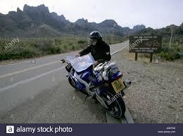 Big Bend National Park Map A Motorcyclist Checks A Map In The Big Bend National Park Texas
